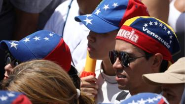 "Opposition supporters take part in a rally against Venezuelan President Nicolas Maduro""s government in Caracas, Venezuela February 2, 2019"
