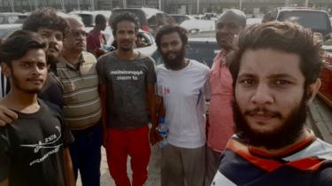 The sailors pictured in Nigeria soon after their release