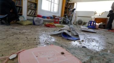 Objects are scattered in a house that was hit by a rocket fired from the Gaza strip in the southern Israeli village of Netiv Haasara