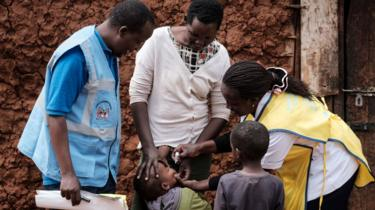 Child getting polio vaccination in Kenya