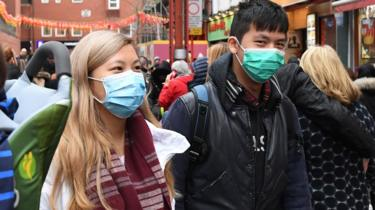 People wearing masks in London
