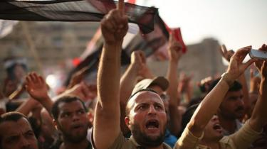 Pro Mohammed Morsi supporters rally near where over 50 were purported to have been killed by members of the Egyptian military and police in early morning clashes on July 8, 2013 in Cairo, Egypt.