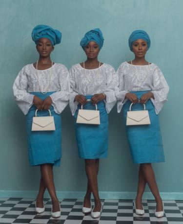 Three models pose in A Ti De