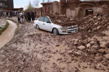 Afghanistan - rubble collapsed on top of a car in Herat