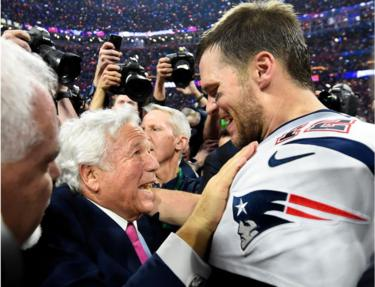 Mr Kraft with New England quarterback Tom Brady