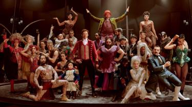 Hugh Jackman with the cast of The Greatest Showman