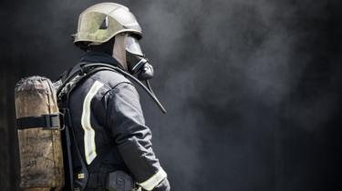 Fireman with protective gear