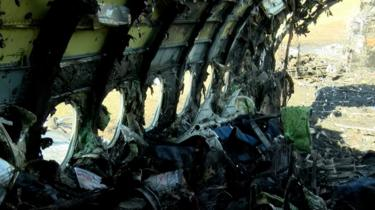 Burnt-out cabin of plane, 6 May 19