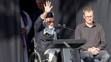 Farid Ahmed, a survicor of the Christchurch shooting, waving to the crowd at the remembrance service on March 29