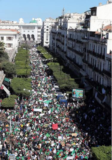 Algerians protesting against President Abdelaziz Bouteflika pictured in the captial, Algiers, on 15 March 2019.