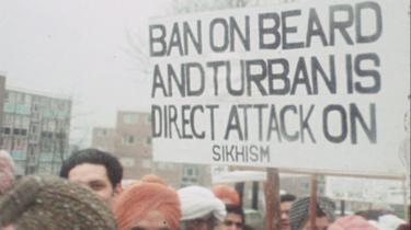 Sikhs striking in Wolverhampton with sign reading 'Ban on beards and turban is direct attack on Sikhism'