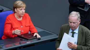 "German Chancellor Angela Merkel (L) and Co-leader of the Alternative for Germany party (AfD) Alexander Gauland during a session of the German parliament ""Bundestag"" in Berlin, Germany, 12 September 2018"