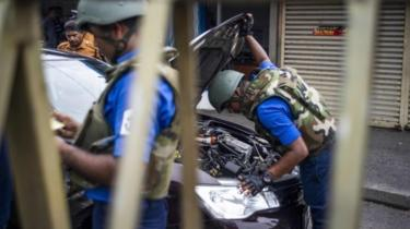 Sri Lankan soldiers inspect a car at a checkpoint in Colombo on April 27, 2019,