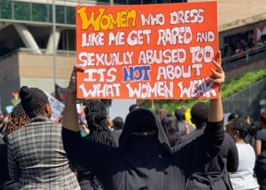 Woman holding up a sign