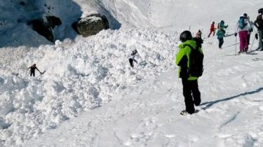 People dig through piles of snow