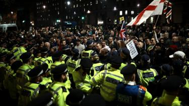 Demonstrators clash with police officers during a pro Brexit rally in Parliament Square