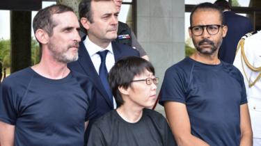 Patrick Picque, left, and Laurent Lassimouillas, right, and a South Korean hostage who has not been named