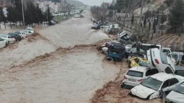 Vehicles are stacked one against another after a flash flooding In Shiraz, Iran, March 25, 2019
