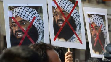 Indian activists carry placards of the chief of Jaish-e-Mohammad, Maulana Masood Azhar during a protest against the attack on the air force base in Pathankot, in Mumbai on January 4, 2016