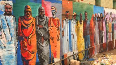 A mural of Sudanese people on a wall in Khartoum, Sudan