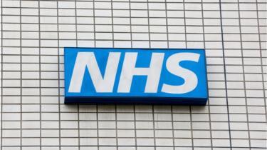 NHS logo on hospital building