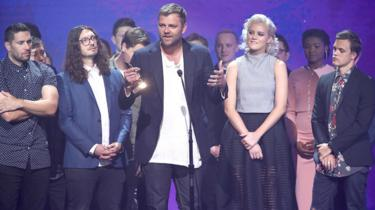 Aodhan King of Hillsong United accepts an award onstage during the 2016 Dove Awards in Nashville, a Christian music awards show