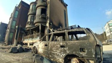Buildings and vehicle damaged during a wildfire are seen in Goseong, South Korea, April 5, 2019