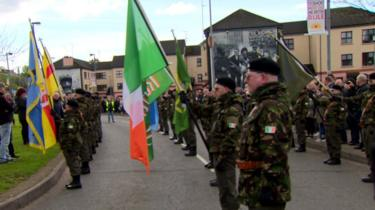People in paramilitary-style uniforms leading an Easter parade organised by Saoradh in Derry in 2017