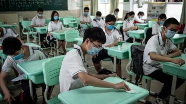 Senior middle school students prepare for class in Wuhan, China's central Hubei province on May 20, 2020