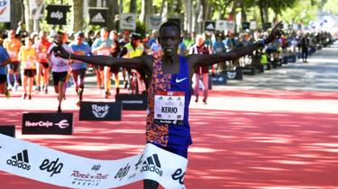 Kenya's Reuben Kerio celebrates while crossing the finish line to win the 42nd Madrid Marathon in Madrid, Spain, 27 April 2019