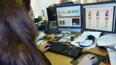 woman looking at screen with three images of a model in underwear