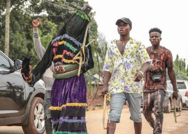 A masquerade group parading through the streets of Arondizuogu during the Ikeji Festival in Nigeria