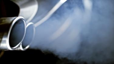 Exhaust fumes coming out of car exhaust pipes