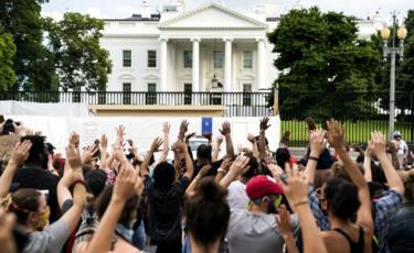 People gather outside the White House during a protest over the Minneapolis, Minnesota, arrest of George Floyd, who later died in police custody, 29 May 2020