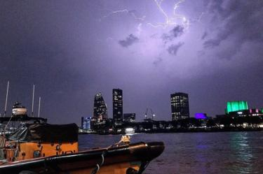 lightning illuminating the sky over the Southbank on the River Thames in London
