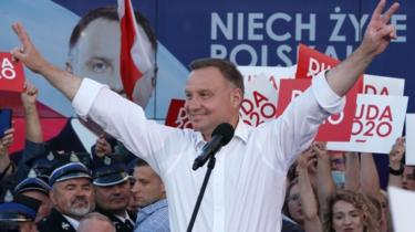 Polish President Andrzej Duda raising his arms on the campaign trail, July 2020