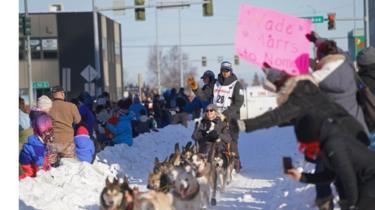 Reigning winner Joar Leifseth Ulsom rides through Anchorage