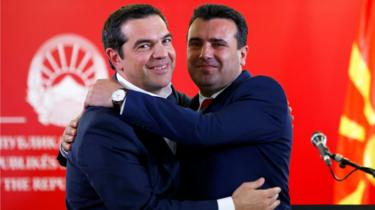 Greek Prime Minister Alexis Tsipras (L) and North Macedonian Prime Minister Zoran Zaev hug as they attend a news conference in Skopje, North Macedonia April 2, 2019