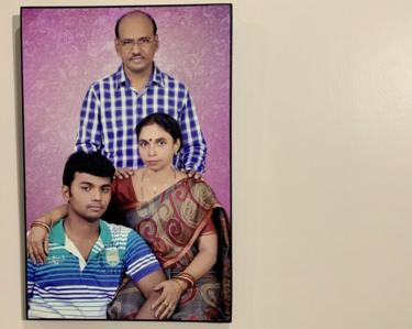Choudhury family portrait hanging on the wall of their home