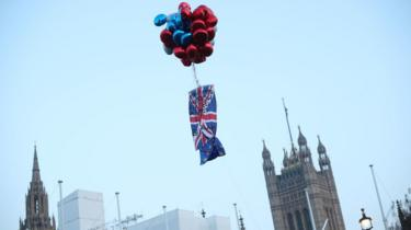 Brexit protesters release balloons in Parliament Square, Westminster, London, during The March to Leave protest
