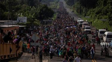 A migrant caravan from Central America proceeds towards Tapachula from Ciudad Hidalgo, after crossing the Guatemala border into Mexico, while en route to the United States on October 21, 2018