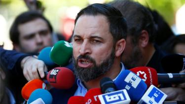 Spain's far-right party Vox candidate Santiago Abascal talks to the media after casting his vote