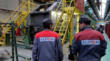 Employees work at the Alstom high-speed train TGV factory in Belfort, eastern France (file picture)