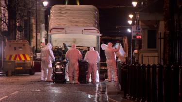 car being removed from scene of derry bomb