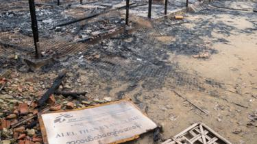 Burned Clinic in Al Lel Than Kyaw, with a sign showing the MSF logo