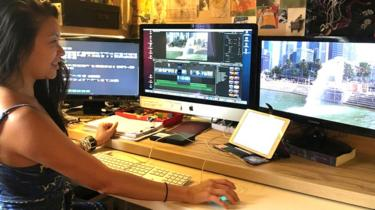 Ying Li Looi-Garman at her desk