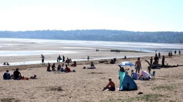 Sunbathers in Swansea Bay