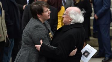 Irish President Michael D Higgins consoles Sara Canning, partner of the murdered journalist Lyra McKee