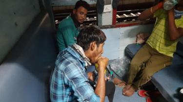 Workers on board the special train carrying 1,200 passengers to eastern Jharkhand state