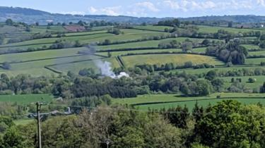 Smoke seen rising over countryside